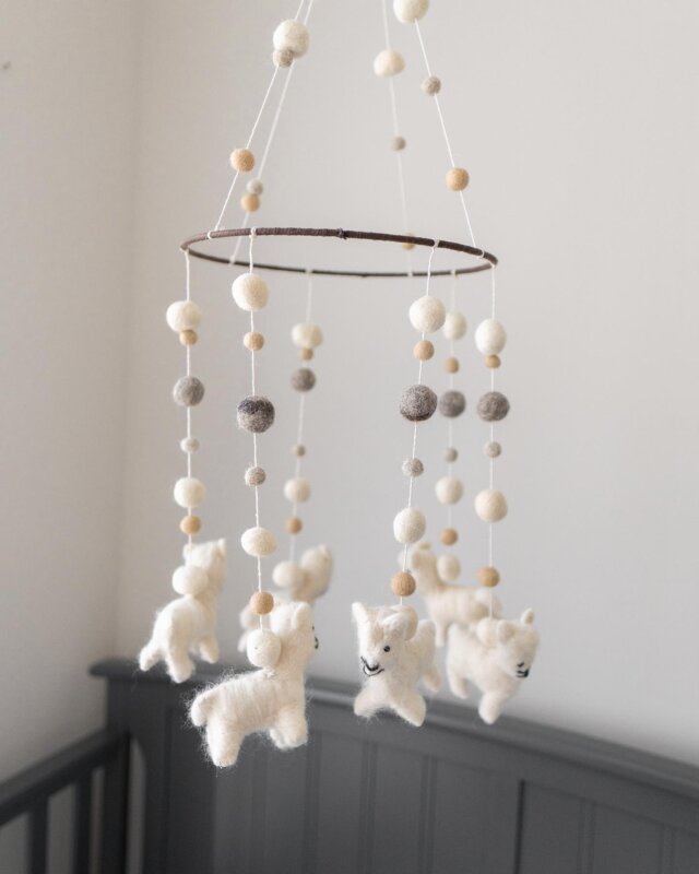 Sheep dreams, little one! 🤍  Baby will be counting llamas to fall asleep with Linen Perch's felt Llama Nursery Mobile. This beautiful mobile is crafted by hand using neutral-toned wool felt pom-poms, adding a touch of whimsy that matches whatever your nursery theme is. We love the fun and interesting texture this piece introduces to a space— it also makes for a great baby shower gift!   Check it out on the Linen Perch website (link in bio)!  #neutralnursery #neutralnurserydecor #modernnursery #bloggerstyle #momsofinstagram #mommyblogger #lifestyleblogger #lifestyle #babyroom #babyfashion #babygirl #babyboy #nursery #nurserydecor #bohonursery #changingbasket #throwset #throwpillows #throwblanket #pampasgrass #decorinspo #daddyblogger #dadsofinstagram #babyboho #babyshower #babyroominterior #kidroomdecor #linenperch #trendingnow
