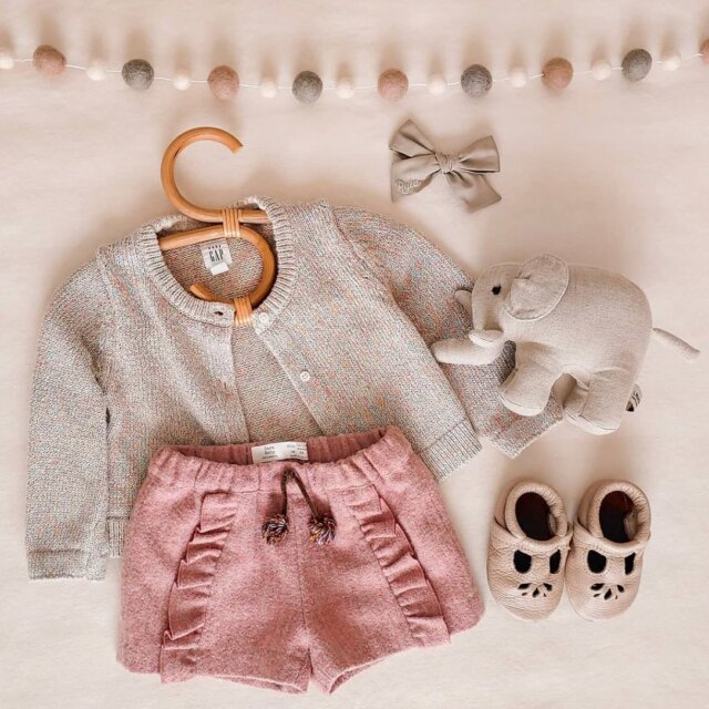 Pretty in pink 💕  Such an adorable #BabyOOTD by @ryla.ly featuring our Rattan Children's Hangers, Pom-Pom Garland, and Linen Friend 'Baby Enzo' the Linen Stuffed Elephant! What is your little one wearing this season?   Check out these adorable must-haves at the Linen Perch website (link in bio)!
