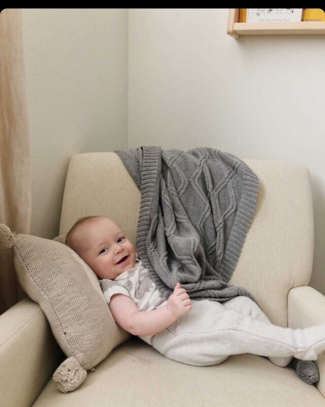 #CozyCorner time!   Look at this cutie snuggled up with our Cable Knit Pom-Pom Blanket in Grey and Llama Throw Pillow. These favorites are made with 100% cotton, and add pretty (and comfy) details to your nursery or playtime space.   Check these favorites out at the Linen Perch website (link in bio)!  #babyshowergift #throwpillows #throwblanket #nursery #nurserydecoration #nurseryinspiration #nurseryinspo #nurseryideas #throwpillows #cutepillows #nurserygift  #babygifts #cottonpillows #babydecorideas #babynurserydecor #babyshowgifts #bestbabygifts #babyshower #lamapillow #cutethrowpillow #giftideas #linenperch #nurserydecor #cutepillows