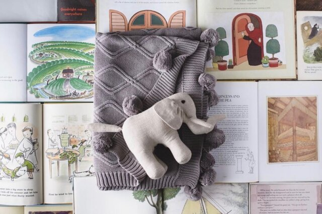 """The story time essentials that you didn't know you needed! Linen Perch's Cable Knit Pom-Pom Blanket (pictured here in grey) pairs nicely with our """"Momma and Baby Enzo"""" Natural Linen Elephant Duo for a cozy story sesh.  Find both of these products on Linen Perch's website to make reading-time— or anytime— better with your little one! See the link in our bio.  nursery #nurserydecor #stuffedanimal #kidsgift #lp #neutralnursery #neutralnurserydecor #modernnursery #bohonursery #momlife #momsofinstagram #blanket #cozyhome #chicnursery #babygirl #babyboy #babyboho #babyroominterior"""