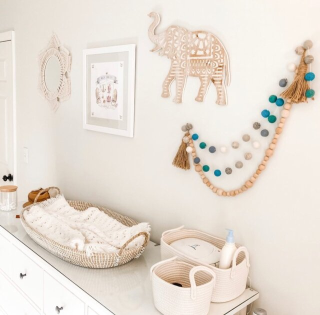 🤍 Boho nursery dreams 🤍   We are obsessed with these cozy nursery neutrals styled by @workout_baby_work ! Featured here is our best-selling Charleston Baby Changing Basket and our Decorative Pom-Pom Garland (in Blue/Grey)— which adds such a fun pop of color and texture!  Check out these nursery essentials on the Linen Perch website (link in bio)!